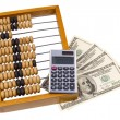Stock Photo: Old wooden abacus, calculator and U.S. dollars