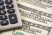 Calculator on US dollars background — Stock Photo