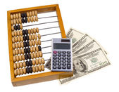 Old wooden abacus, calculator and U.S. dollars — Stock Photo