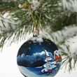 New Year's sphere on a snow-covered fur-tree — Stock Photo #4333313