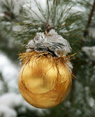 New Year's sphere on a snow-covered fur-tree — Stock Photo