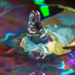 Water drop on a multi-coloured background — Stock Photo