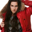 Stock Photo: The girl in a red jacket on a white background