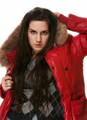 The girl in a red jacket on a white background — Stock Photo
