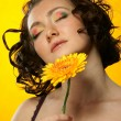 The girl with Gerber's flower — Stock Photo