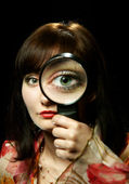 The girl with a magnifier — Stock Photo