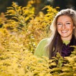 Caucasian young adult blond woman outdoor fall time — Stock Photo
