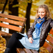 Girl in golden autumn park — Stock Photo