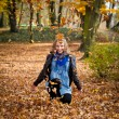 Girl in golden autumn park — Stock Photo #4214338