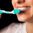 Woman healthy teeth closeup with toothbrush on black background — Stock Photo #4308738