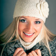 Portrait of beautiful blond woman in warm clothes on blue background — Stock Photo