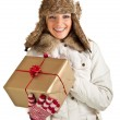 Caucasian blond woman in furry hat and christmas gifts isolated on white — Stock Photo #4376785
