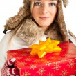 Caucasian blond woman in furry hat and christmas gifts isolated on white — Stock Photo