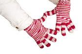 Frau hand in bunte und warme handschuhe, isoliert auf weiss — Stockfoto