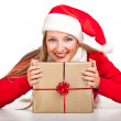 Woman in santa hat with christmas presents — Stock Photo #4416021