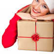 Woman in santa hat with christmas presents — Stock Photo #4416023