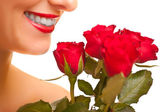 Beautiful caucasian woman with red roses on white isolated backg — Foto Stock