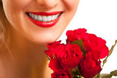 Beautiful caucasian woman with red roses on white isolated backg — Stok fotoğraf