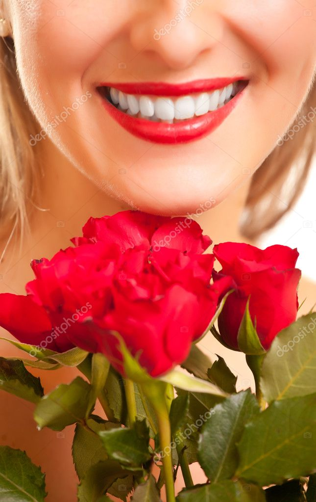 Beautiful caucasian woman with red roses on white isolated background — Stock Photo #4620006