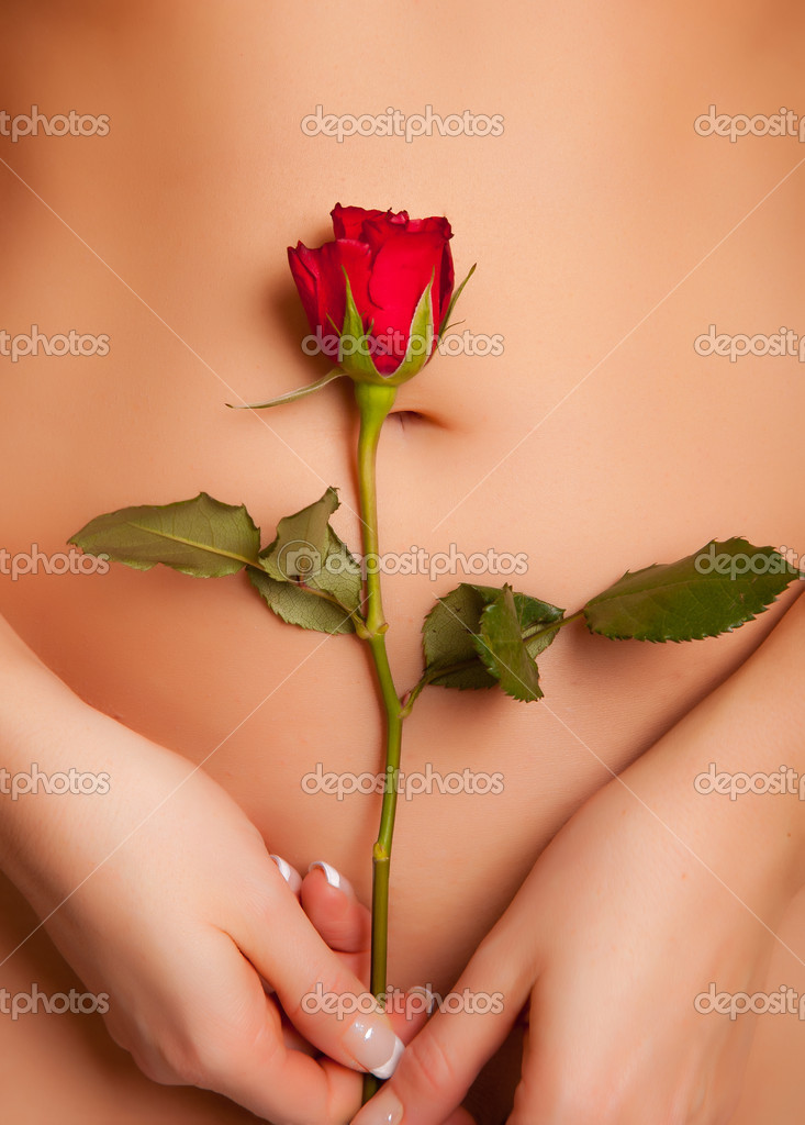Nude caucasian woman holding red rose  Foto Stock #4620086