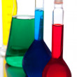 Labolatory glassware with colorful fluids isolated on white - Stock Photo