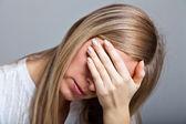 Depressed, sad woman on neutral background — Stock Photo