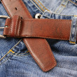 Blue jeans and a brown leather belt. — Stock Photo