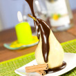 Pear in chocolate — Stock Photo