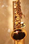 Golden Sax Against Golden Bokeh Background — Stock Photo