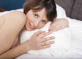 Beautiful girl on the bed — Stock Photo