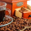 Arrangement with the coffee grinder, coffee beans and a cup of coffee — Stock Photo
