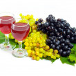Arrangement of grapes and a glass of wine — Stock Photo