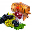Arrangement of grapes with a wine barrel of wine and glasses — Stock Photo