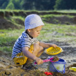 Stock Photo: Little child play with sand
