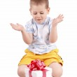 Little boy and gift — Stock Photo #5127443