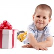 Little boy and gift — Stock Photo #5127450
