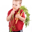 Stock Photo: Boy and carrot