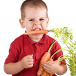 Boy and carrot — Stok fotoğraf