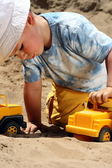 Little child play with sand — Stockfoto