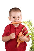 Boy and carrot — Stock Photo