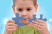 Boy with puzzles — Stock Photo