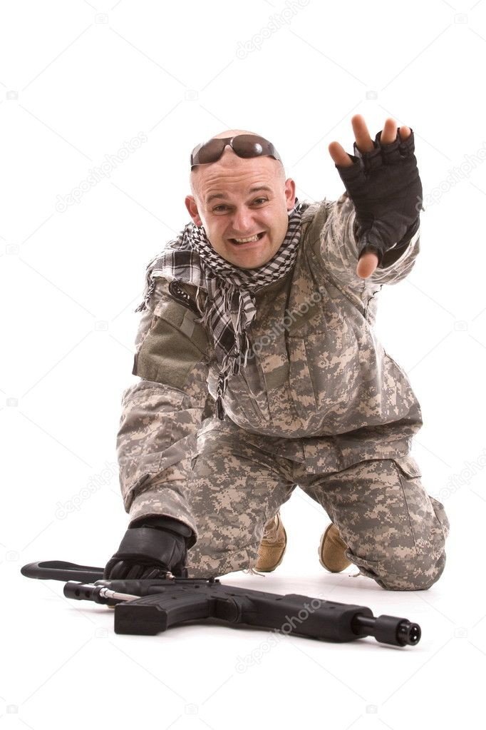 Soldier with hands up, isolated in white  Stock Photo #5126991