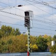 Stock Photo: Three signals and overhead wire