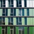 Modern facade in different shades of green - Photo