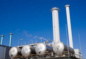Tanks and smokestacks — Stock Photo