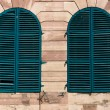 Old windows with green shutters — Stock Photo