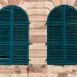 Stock Photo: Old windows with green shutters