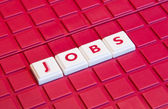 The word Jobs written in small plastic letters — Stock Photo