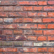 Stock Photo: Brickwall with writings