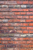 Brickwall with writings — Stock Photo